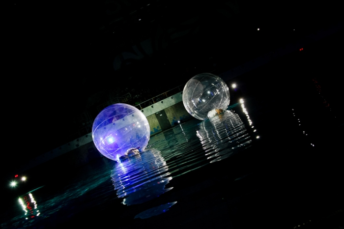 Fairy show act on the water with floating transparent bubbles.